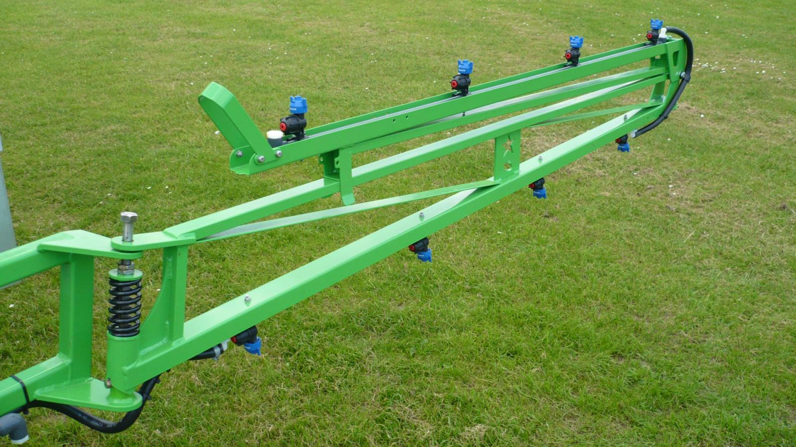 Folded optional boom extensions on STARGREEN's AS600Pro and AS800Pro tractor-mounted amenity sprayers