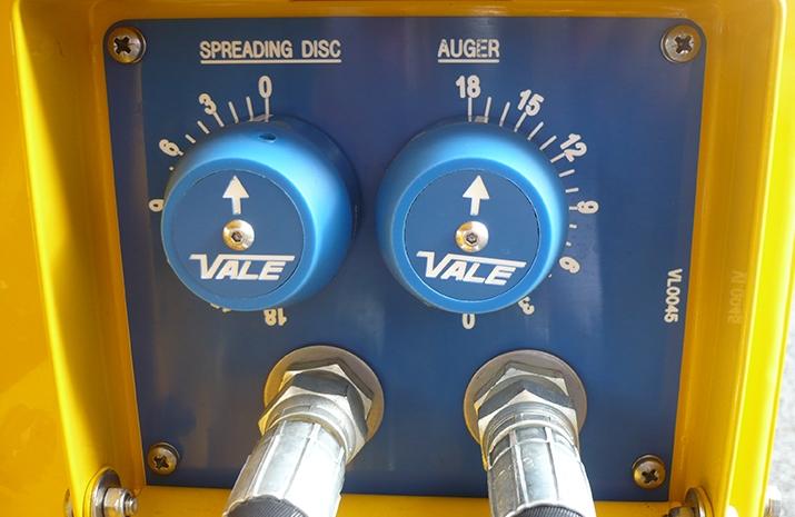 Spreading and Auger controls on Salt Spreader/Snowplough Mini-Tractor Combi
