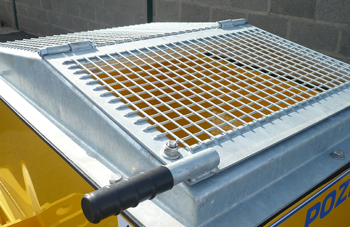 Salt spreader has a galvanized pitched mesh which can be opened