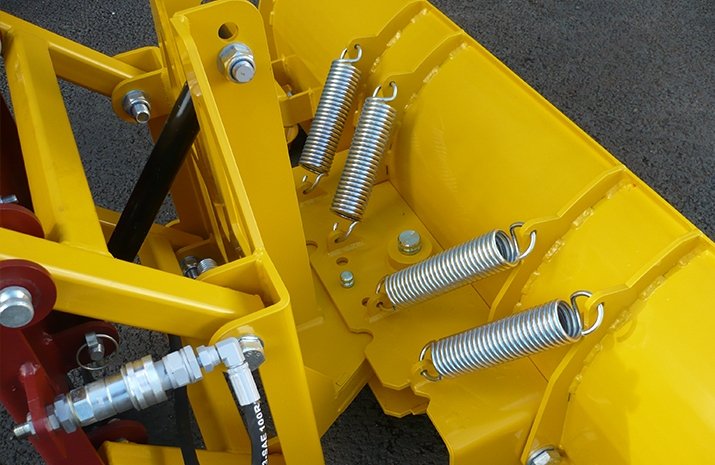 The snow plough attachment is fitted with a break-back system to reduce the likelihood of damage to the snow plough, the compact tractor or the driver.