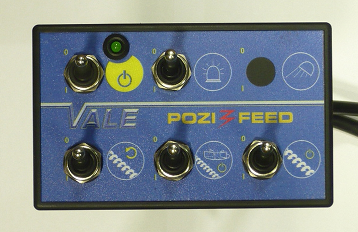 POZI-FEED in-cab control box to control Spreading Disc/Auger on-off, Reverse, Beacon & Work light