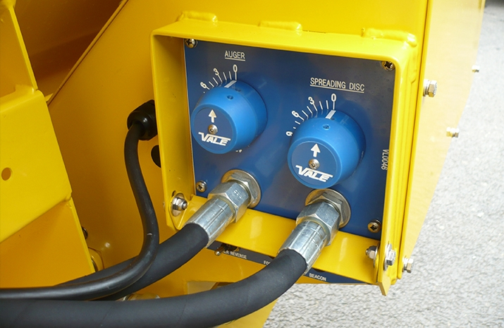 Manually adjustable spread width valve & application rate valve (graduated) on the VALE TS500 Tractor Towed Salt Spreader (Gritter)