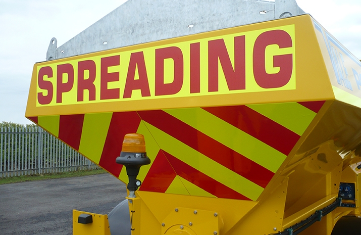 Fluorescent markings on the rear of the Tractor Towed Salt Spreader (Gritter) VALE TS5000 from VALE Engineering