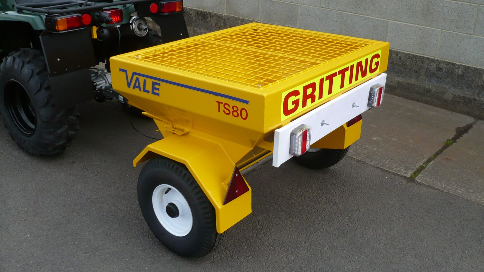 The ATV quad bike comes with VALE Engineering's Towed Drop Gritter TS80